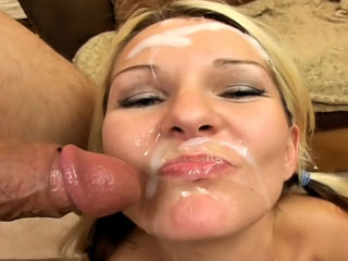 Sweet blonde enjoys sperm shower on her face after sucking