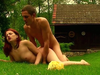 Green grass is being used by a stud for fucking a redhead whore